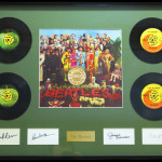 Beatles Album with 45's and signatures